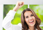 Happy gesturing smiling young businesswoman — Stock Photo