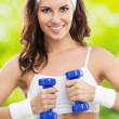 Woman exercising with dumbbell, outdoors — 图库照片