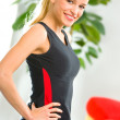 Cheerful woman in fitness wear indoors — Stock Photo