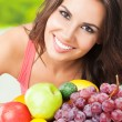 Woman with plate of fruits, outdoors — Stock Photo #28813093