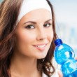 Woman with bottle of water, at fitness club — Stock Photo #29707965