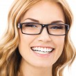 Cheerful smiling woman in glasses, isolated — Stock Photo #29708159