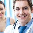 Stock Photo: Portrait of smiling doctor and female patient