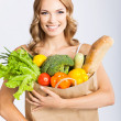 Woman with vegetarian food — Stock Photo