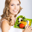 Woman with vegetarian salad, over gray — Stock Photo #29815239