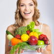 Young woman with vegetarian food, over gray — Stock Photo #29815245