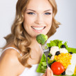 Woman with vegetarian salad, over gray — Stock Photo #29815297
