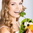 Woman with vegetarian salad, over gray — Stock Photo #29815383