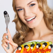 Woman with vegetarian salad, over gray — Stock Photo #29815397