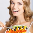 Woman with vegetarian salad, over gray — Photo