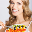 Woman with vegetarian salad, over gray — Stock Photo #29815413