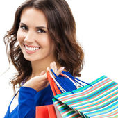 Young happy woman with shopping bags, isolated — Stockfoto