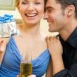 Cheerful amorous couple with gifts, indoors — Stock Photo