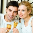 Cheerful couple with champagne — Stock Photo #30111861