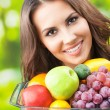 Woman with plate of fruits, outdoors — Stock Photo #30341137