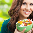 Young womwith salad, outdoors — Stock Photo #30341177