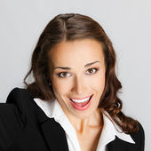 Happy business woman, over gray — Stock Photo