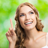 Woman, showing one finger or idea gesture, outdoor — Stock Photo