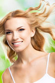 Happy smiling woman with long hair, outdoors — Stock Photo