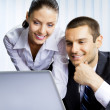 Stock Photo: Two business people working with laptop