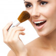 Young woman with cosmetics brush, isolated — Stock Photo #31161301