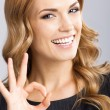 Businesswoman with okay gesture, on gray — Stock Photo #32087123