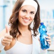 Woman with bottle of water, at fitness club — Stock Photo #32817129