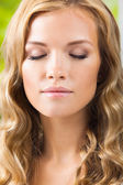 Blond woman with closed eyes — Stock Photo