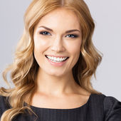 Young cheerful business woman, on gray — Stock Photo