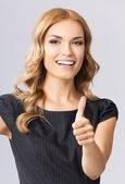 Businesswoman with thumbs up gesture, on gray — Stock Photo