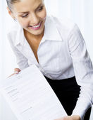 Smiling businesswoman showing document — Stock Photo