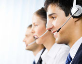Three customer support phone operators — Stockfoto
