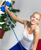 Woman exercising with dumbbells and growth — Stock Photo