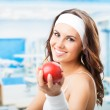 Woman with apple, at fitness center — Stock Photo #36637683