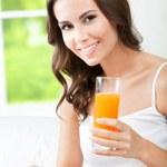 Happy woman drinking juice — Stock Photo