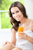 Happy woman drinking juice — Stock Photo