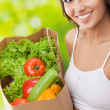 Woman in fitness wear with vegetarian food — Stock Photo #38280479