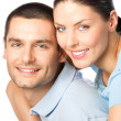Portrait of young happy smiling attractive couple, isolated on w — Stock Photo #38280751