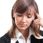 Serious thinking businesswoman, on white — Stock fotografie
