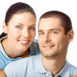 Portrait of young happy smiling attractive couple, isolated on w — Stock Photo #39425463