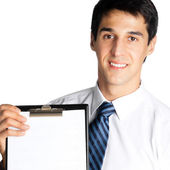 Businessman showing blank clipboard, isolated — Stock Photo
