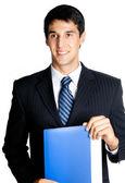 Businessman with blue folder, isolated — Stock Photo