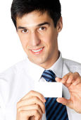 Portrait of smiling businessman giving blank business card — Stock Photo