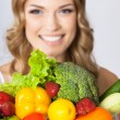 Young woman with vegetarian food, over gray — Stock Photo #41560163