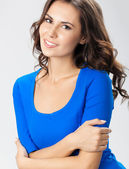 Happy smiling young woman, over grey — Stock Photo