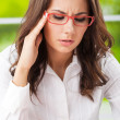 Stock Photo: Thinking, tired or ill with headache businesswoman