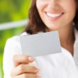 Businesswoman showing blank business card — Stock Photo