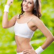 Stock Photo: Young womin fitness wear, outdoors
