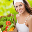 Stock Photo: Womin fitness wear with vegetarifood