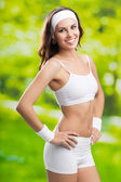 Young woman in fitness wear, outdoors — Stock Photo